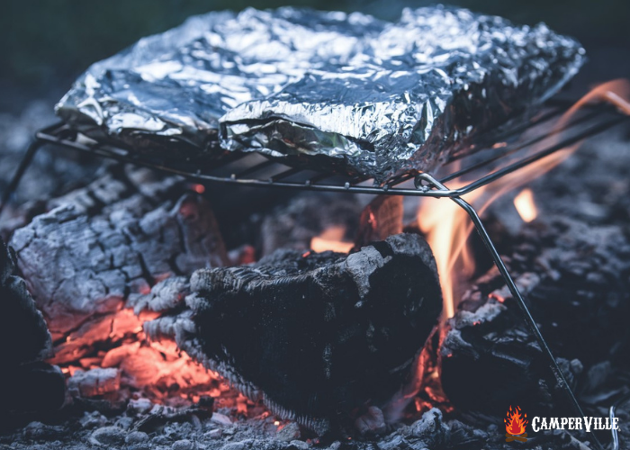 foil packet camping meals cooking on a fire while camping